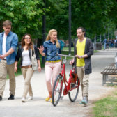 Students with bicycles in a park in Berlin.