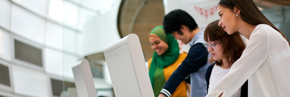 International students look at various funding programmes on the PCs in the library.